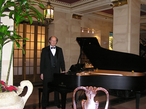Playing piano at the Davenport Hotel